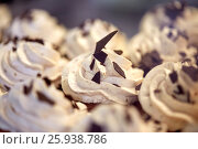 Купить «close up of cupcakes or muffins with frosting», фото № 25938786, снято 3 октября 2016 г. (c) Syda Productions / Фотобанк Лори