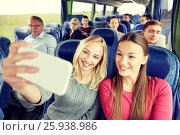 women taking selfie by smartphone in travel bus. Стоковое фото, фотограф Syda Productions / Фотобанк Лори