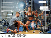 Купить «man and woman with barbell flexing muscles in gym», фото № 25939094, снято 19 апреля 2015 г. (c) Syda Productions / Фотобанк Лори