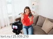 Купить «woman with bronzer and camera recording video», фото № 25939210, снято 22 декабря 2016 г. (c) Syda Productions / Фотобанк Лори