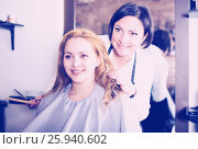 Купить «Woman consults with master in hairdress», фото № 25940602, снято 7 марта 2017 г. (c) Яков Филимонов / Фотобанк Лори