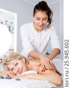 Купить «Woman having professional massage in spa salon», фото № 25945602, снято 9 февраля 2017 г. (c) Яков Филимонов / Фотобанк Лори