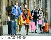 Купить «Young adults in shopping tour», фото № 25945694, снято 18 сентября 2018 г. (c) Яков Филимонов / Фотобанк Лори