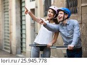 Купить «Young couple driving segways», фото № 25945778, снято 17 ноября 2018 г. (c) Яков Филимонов / Фотобанк Лори