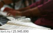 Купить «Musical notes kept next to the piano», видеоролик № 25945890, снято 18 ноября 2019 г. (c) Wavebreak Media / Фотобанк Лори