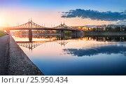 Купить «Evening at Starovolzhsky Bridge in Tver with reflection in the waters of the Volga River», фото № 25950434, снято 3 мая 2016 г. (c) Baturina Yuliya / Фотобанк Лори