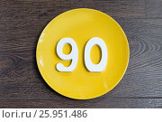 Купить «Figure ninety on the yellow plate», фото № 25951486, снято 23 марта 2017 г. (c) Григорий Алехин / Фотобанк Лори