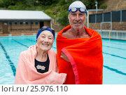 Купить «Senior couple wrapped in towel at poolside», фото № 25976110, снято 12 декабря 2016 г. (c) Wavebreak Media / Фотобанк Лори