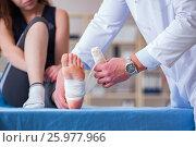 Купить «Traumatologist is taking care of the patient», фото № 25977966, снято 9 февраля 2017 г. (c) Elnur / Фотобанк Лори