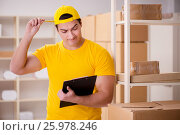 Купить «Man working in postal parcel delivery service office», фото № 25978246, снято 13 февраля 2017 г. (c) Elnur / Фотобанк Лори