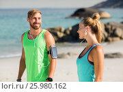 Купить «Couple listening music while standing at beach», фото № 25980162, снято 17 января 2017 г. (c) Wavebreak Media / Фотобанк Лори