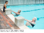 Купить «Trainer interacting with senior women at poolside», фото № 25981102, снято 12 декабря 2016 г. (c) Wavebreak Media / Фотобанк Лори
