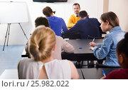 Купить «Female student looking at test variant of her neighbor», фото № 25982022, снято 28 февраля 2017 г. (c) Яков Филимонов / Фотобанк Лори