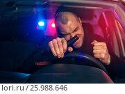 Купить «Upset drunk driver in car is caught by police», фото № 25988646, снято 21 ноября 2016 г. (c) Pavel Biryukov / Фотобанк Лори
