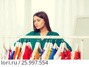 Купить «woman choosing clothes at home wardrobe», фото № 25997554, снято 19 февраля 2016 г. (c) Syda Productions / Фотобанк Лори