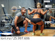 Купить «man and woman with barbell flexing muscles in gym», фото № 25997606, снято 19 апреля 2015 г. (c) Syda Productions / Фотобанк Лори