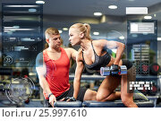 Купить «young couple with dumbbell flexing muscles in gym», фото № 25997610, снято 19 апреля 2015 г. (c) Syda Productions / Фотобанк Лори