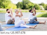 Купить «people making yoga and meditating outdoors», фото № 25997678, снято 7 августа 2016 г. (c) Syda Productions / Фотобанк Лори