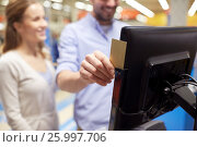 Купить «couple with customer card at store self-checkout», фото № 25997706, снято 21 октября 2016 г. (c) Syda Productions / Фотобанк Лори