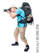 Купить «Photographer in ambush with a big backpack on a white background», фото № 26000358, снято 22 июня 2016 г. (c) Константин Лабунский / Фотобанк Лори
