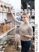 Купить «Attractive blond woman choosing cereals», фото № 26001750, снято 24 января 2020 г. (c) Яков Филимонов / Фотобанк Лори