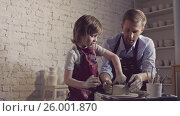 Купить «Teacher and child in studio», видеоролик № 26001870, снято 6 декабря 2019 г. (c) Raev Denis / Фотобанк Лори