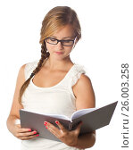 Купить «Girl with glasses reading a book», фото № 26003258, снято 6 июля 2011 г. (c) Tatjana Romanova / Фотобанк Лори