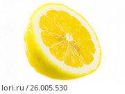 Fresh sliced lemon isolated on white. Стоковое фото, фотограф Михаил Аникаев / Фотобанк Лори