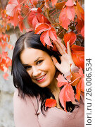 Купить «Pretty young woman portrait in Red Autumn leaves», фото № 26006534, снято 18 июля 2018 г. (c) age Fotostock / Фотобанк Лори