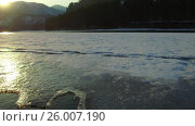 Купить «Mooving along tracery edge of an ice floe on Altai river Katun in Spring season at sunset time», видеоролик № 26007190, снято 16 марта 2017 г. (c) Serg Zastavkin / Фотобанк Лори