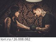 Купить «Professional tattoo artist makes a tattoo on a young girl's hand.», фото № 26008082, снято 8 мая 2016 г. (c) Andrejs Pidjass / Фотобанк Лори