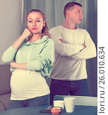 Купить «Husband and pregnant wife arguing at home», фото № 26010634, снято 18 марта 2017 г. (c) Яков Филимонов / Фотобанк Лори