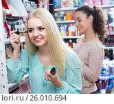Купить «Girls applying mascara near mirror», фото № 26010694, снято 22 сентября 2018 г. (c) Яков Филимонов / Фотобанк Лори
