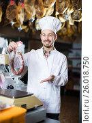 Купить «Seller weighing sausage», фото № 26018750, снято 2 января 2017 г. (c) Яков Филимонов / Фотобанк Лори