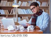 Купить «Young book writer writing in library», фото № 26019190, снято 4 ноября 2016 г. (c) Elnur / Фотобанк Лори