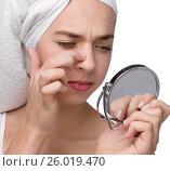 Купить «Close-up of teenager finding an acne on her nose», фото № 26019470, снято 24 марта 2012 г. (c) Tatjana Romanova / Фотобанк Лори