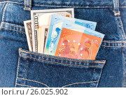 Different banknotes of Euro and american currency sticking out of the back jeans pocket. Money in jeans pocket for travel and shopping, фото № 26025902, снято 21 апреля 2017 г. (c) FotograFF / Фотобанк Лори