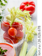 Cherry tomatoes in a glass with celery on a wooden table. Стоковое фото, фотограф Ольга Соловьева / Фотобанк Лори
