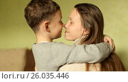 Купить «The happy boy tenderly embraced his mother», видеоролик № 26035446, снято 20 апреля 2017 г. (c) Олег Башкир / Фотобанк Лори