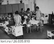 Купить «Дети играют в чаепитие с куклами, в детском саду. 1976 год.», эксклюзивное фото № 26035810, снято 17 апреля 2015 г. (c) Светлана Попова / Фотобанк Лори