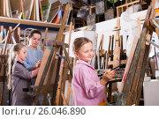 Купить «Children diligently draw the lesson», фото № 26046890, снято 16 октября 2018 г. (c) Яков Филимонов / Фотобанк Лори