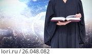 Купить «Midsection of judge holding book against screen», фото № 26048082, снято 16 июня 2019 г. (c) Wavebreak Media / Фотобанк Лори