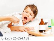 Купить «Sick Caucasian kid boy taking meds laying in bed», фото № 26054158, снято 4 марта 2017 г. (c) Сергей Новиков / Фотобанк Лори