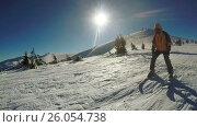 Купить «Man Descent on skis from the snow mountains», видеоролик № 26054738, снято 20 марта 2017 г. (c) Потийко Сергей / Фотобанк Лори