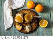 Купить «Апельсины и апельсиновое варенье на деревянном столе крупным планом», фото № 26058278, снято 30 марта 2017 г. (c) Татьяна Ляпи / Фотобанк Лори