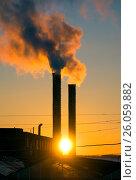 Купить «Emissions from plant pipe against setting sun», фото № 26059882, снято 30 марта 2017 г. (c) Михаил Коханчиков / Фотобанк Лори