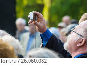 Купить «BERLIN - MAY 08, 2015: Victory in Europe Day. Treptower Park. Participants of commemorative events. The man with photo camera.», фото № 26060082, снято 8 мая 2015 г. (c) Sergey Kohl / Фотобанк Лори