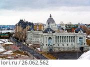 Купить «Palace of farmers and residential complex Dvortsovaya Embankment in Kazan, Russia», фото № 26062562, снято 26 марта 2017 г. (c) Володина Ольга / Фотобанк Лори