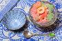 Жевательный мармелад в вазочке на синей салфетке, эксклюзивное фото № 26076870, снято 15 апреля 2017 г. (c) Яна Королёва / Фотобанк Лори