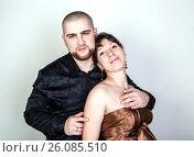 Купить «Man and woman hugging on a gray background», фото № 26085510, снято 26 февраля 2016 г. (c) Александр Калугин / Фотобанк Лори
